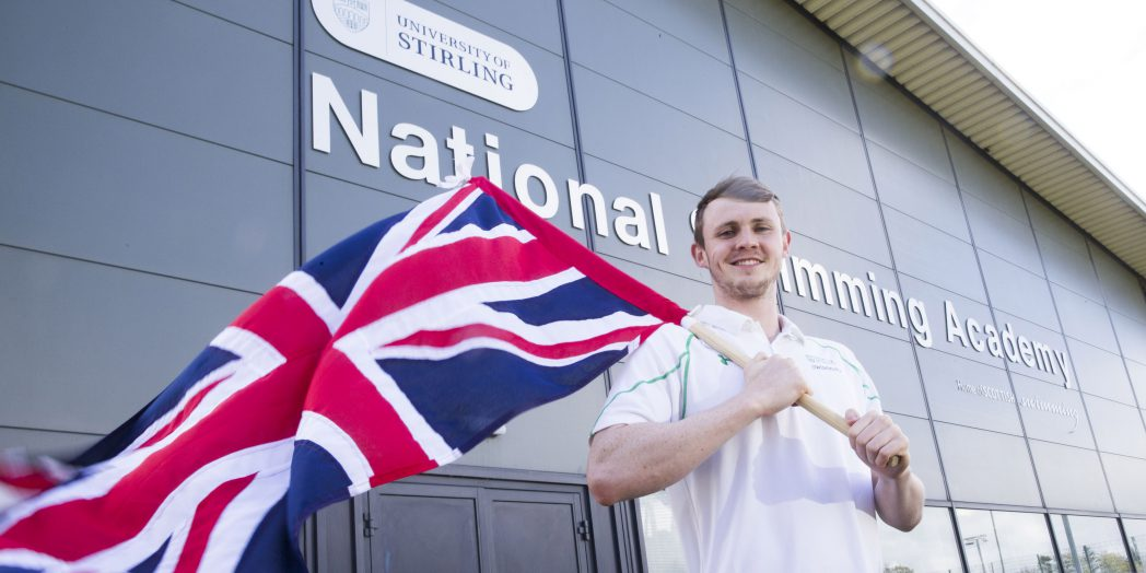Ross Murdoch holding GB flag at Stirling University