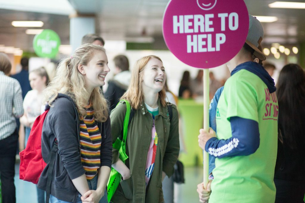 Two people talking to a student ambassador at the University of Stirling's Open Day