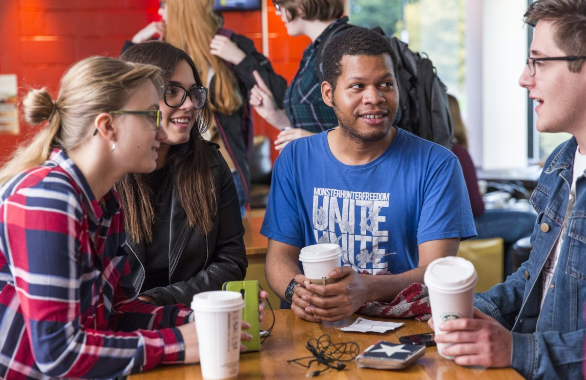 Students drinking coffee at Underground, Stirling Students' Union.