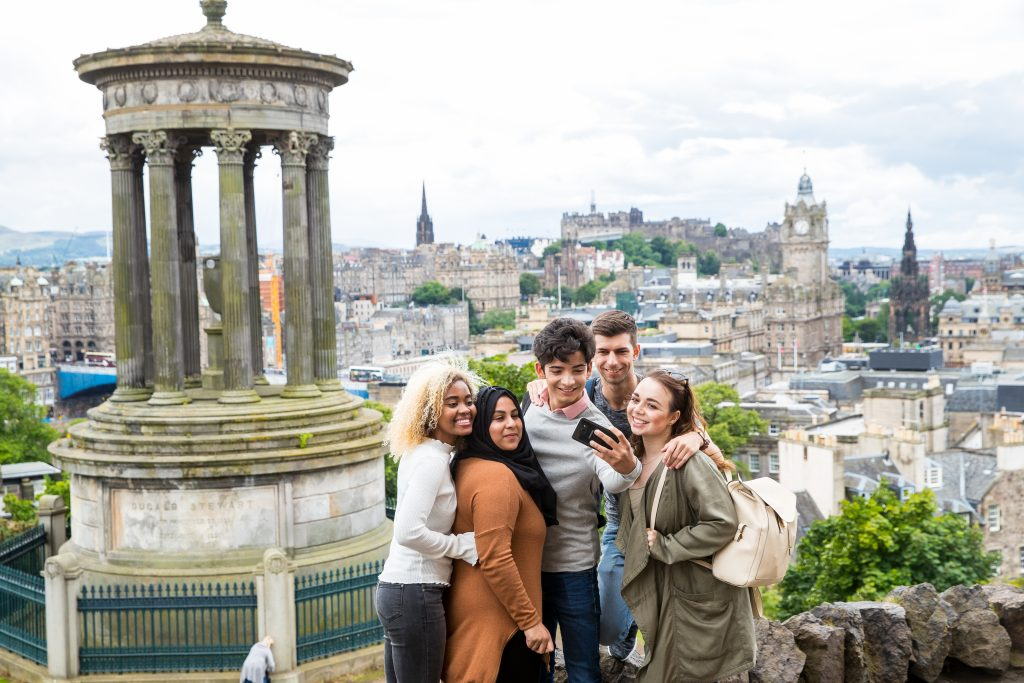 A group of students at Calton Hill in Edinburgh. Perhaps they're discussing Clearing 2018.