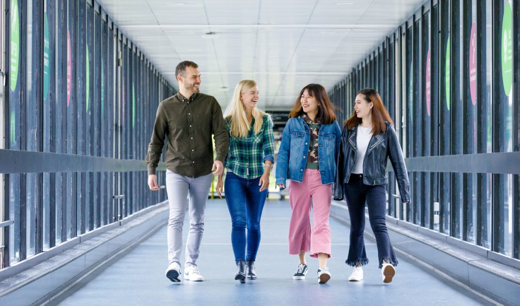 Link bridge with four students walking on a normal day
