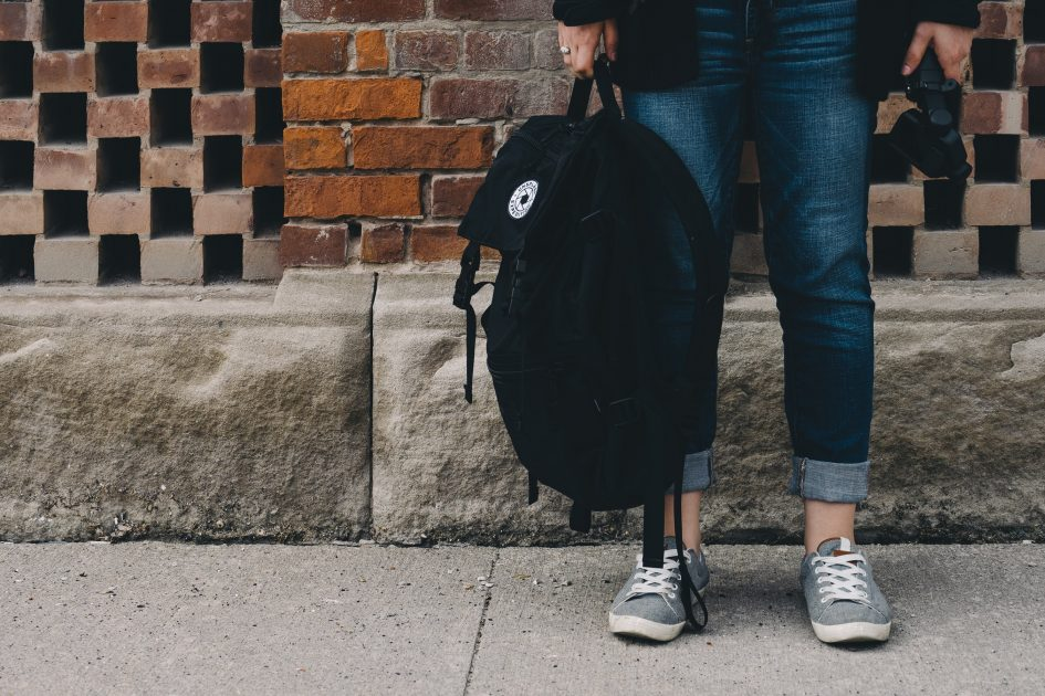 Students legs with bookbag