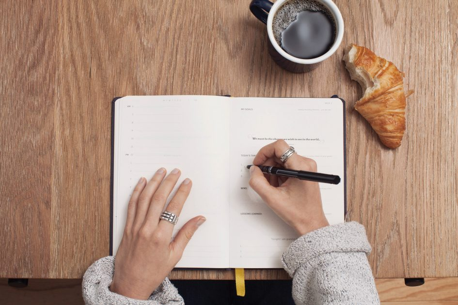 student writing and studying in a notepad