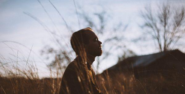 man meditating outside university mental health day