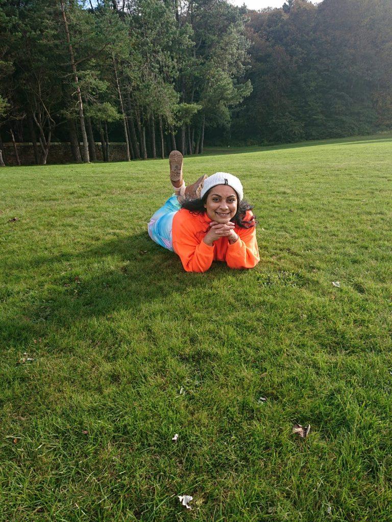 Priya Rawal lying on grass