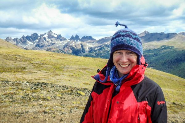 Woman outdoors with hills and mountains in the background