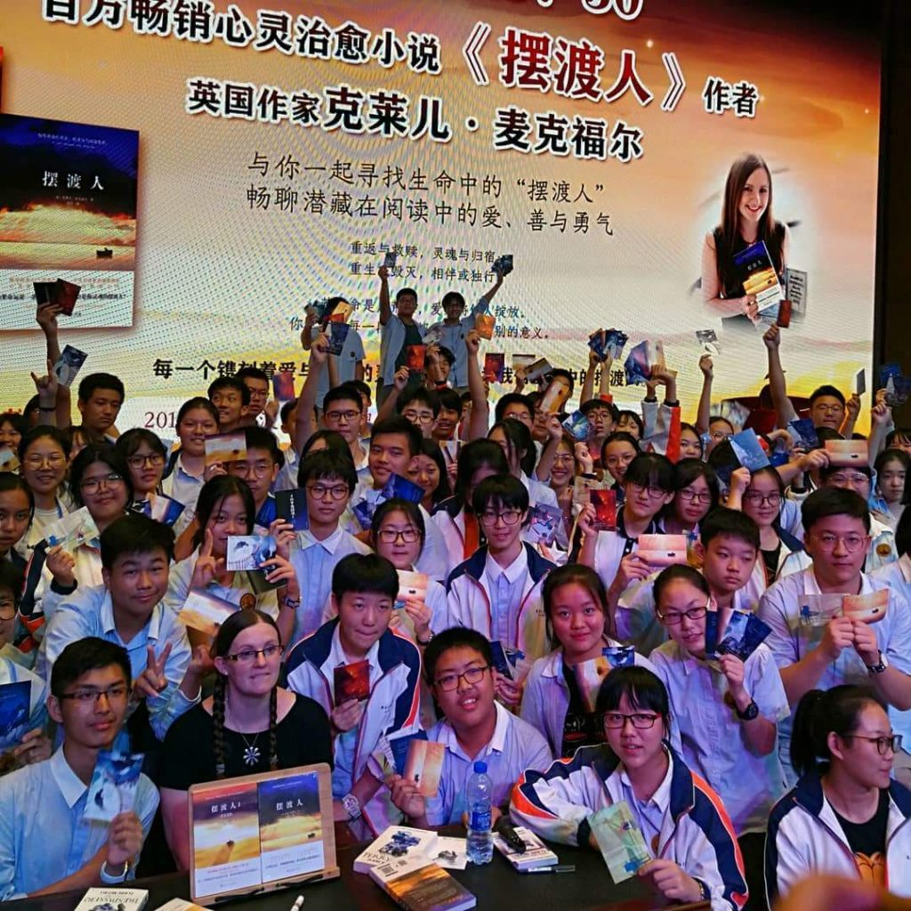 Author smiling at a book event in China.