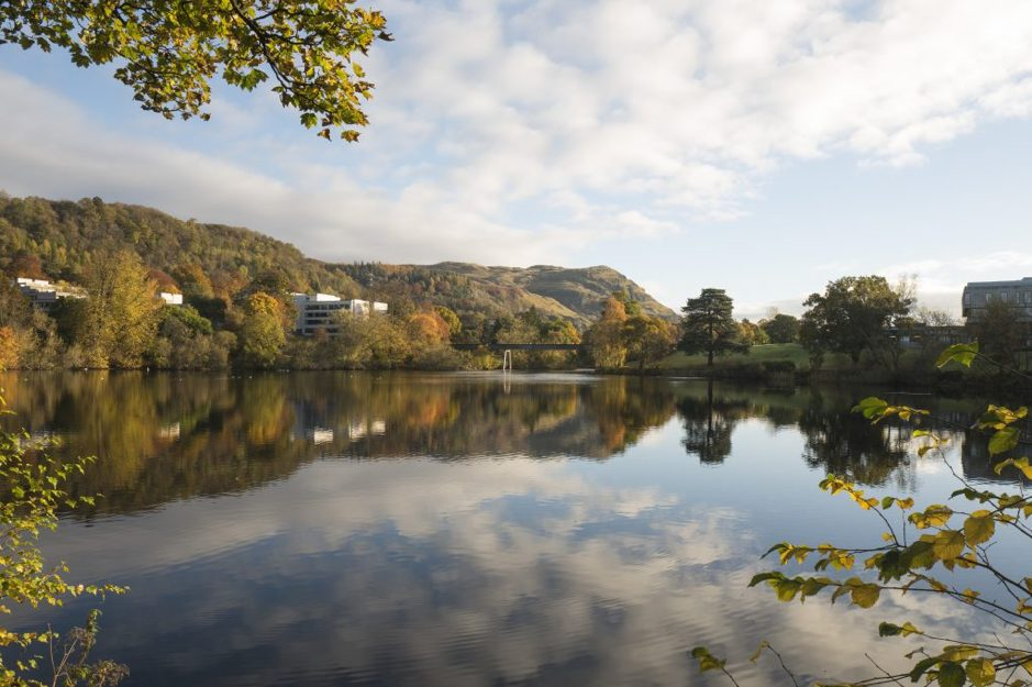 View across Airthrey loch at the University of Stirling with Dumyat in the background.